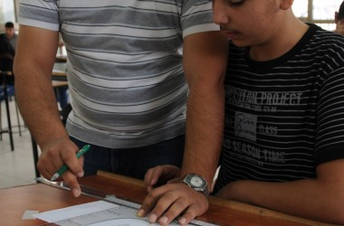 A trainee at the Lutheran World Federation's Vocational Training Program concentrates on his instructor's advice for learning the important skill of drafting. Photo by K. Brown